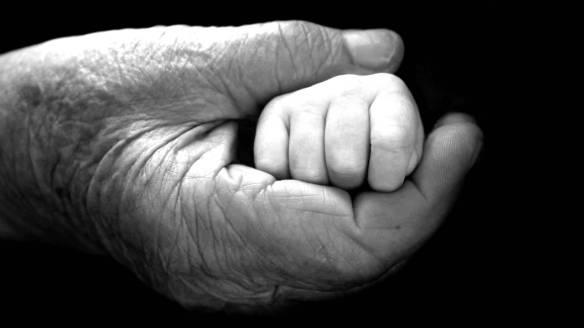 small hand in elderly hand
