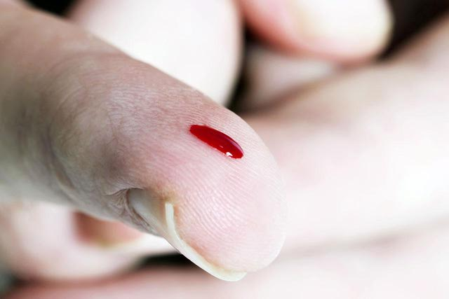 blood drop on finger