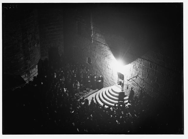 Christmas Eve service in courtyard of Church of the Nativity, circa 1934-1939. Public Domain via Wikimedia Commons