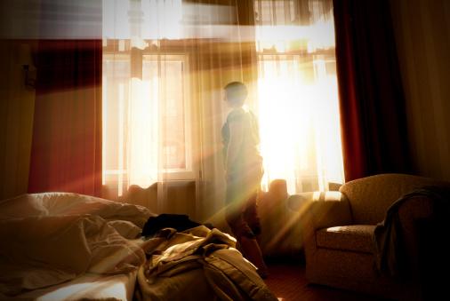 woman sunlight window