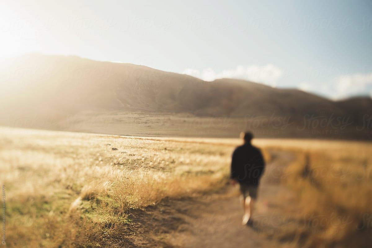 man desert path